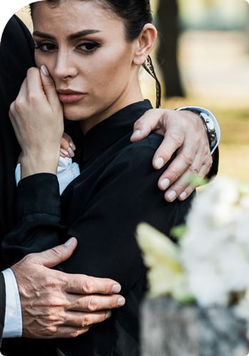 woman being held by someone at a funeral